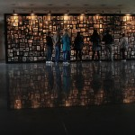Family photographs of prisoners inside the Sauna, or bathhouse, at Auschwitz-Birkenau. The display is meant to give the names back to  the victims of the camp.  Photo by Beth Cortez-Neavel.