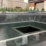 "A view of the fountain located within the site of the North Tower of the World Trade Center, which was destroyed on September 11, 2001. The two fountains, one for each fallen tower, is called ""Reflecting Absence"" and was designed by architect Michael Arad and landscape architect Peter Walker.  Photo by Kai Brinker."